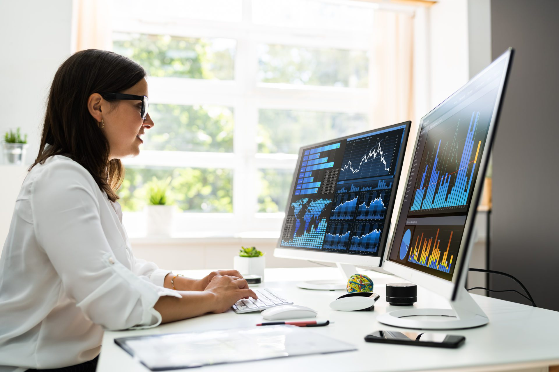 Analyst Women Looking At Data On Computer Screen