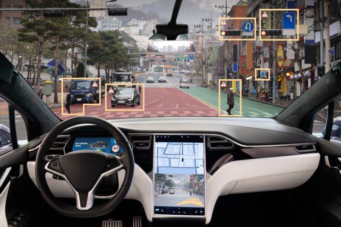 The interior of an autonomous driverless vehicle. Courtesy Adobe.